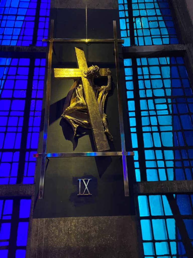 Stained glass windows and sculpture inside Liverpool's Catholic cathedral.