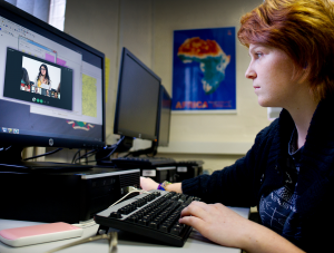 Student participating in an online video conference session.