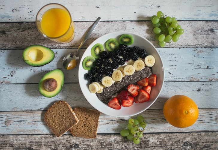 Photograph of a breakfast table with a variety of food.