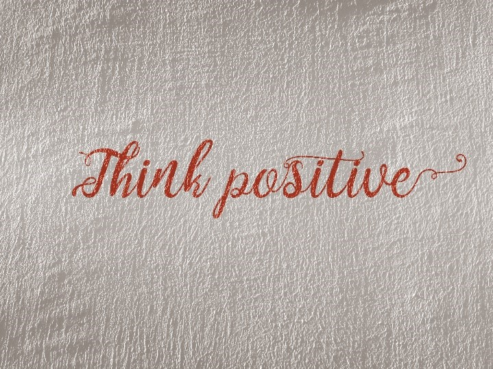 An image that says think positive.