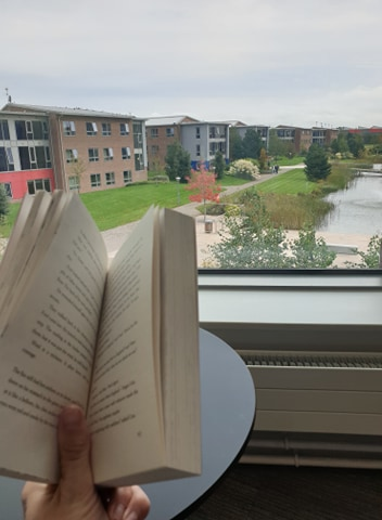 Open book with view over campus.