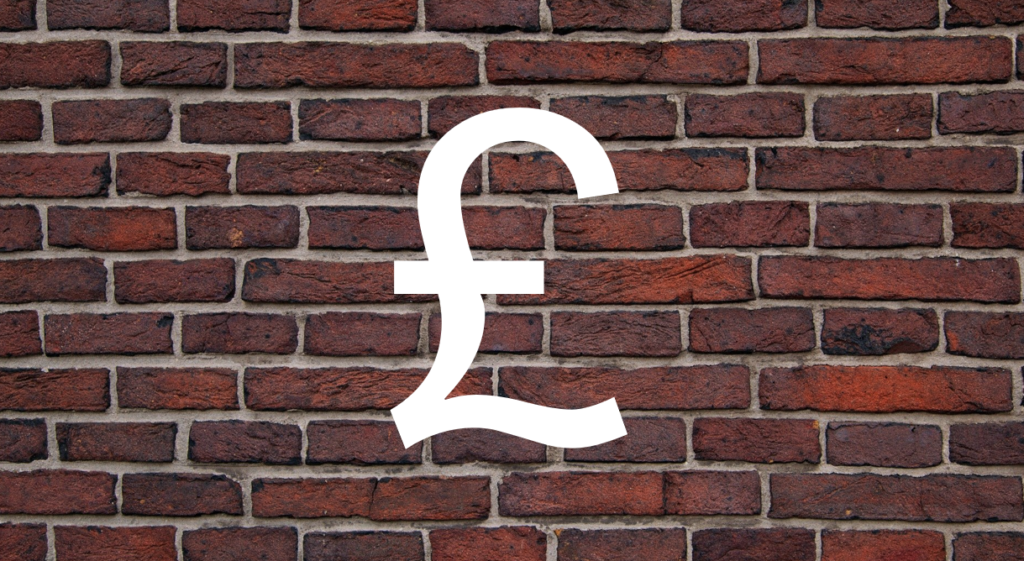 an image of a brick wall with a Great British pound symbol. This represents a paywall